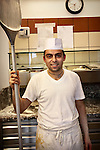 Photo of a pizza chef in the kitchen at Pizzeria Donna Stella in Amalfi, Italy.