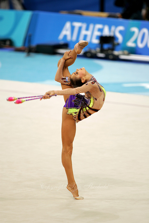 Irina Tchachina of Russia holds balance with clubs at 2004 Athens Olympic Games during qualifying round on August 27, 2006 at Athens, Greece. Irina won silver in the All-Around final. (Photo by Tom Theobald)