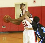 SOUTHBURY, CT, 01/02/08- 010208BZ15- Pomperaug's Dorlen Banks (51) looks for the pass under pressure from Bunnell's Jon Dinihanian (22) during their game at Pomperaug High School in Southbury Wednesday night.<br /> Jamison C. Bazinet Republican-American