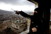 A Free Syrian army soldier looks towards government army positions in Zabadani, the only town in Syria officially held by the rebels.The hill town is surrounded by government forces on high ground. Protests against the ruling Baathist regime of Bashar al-Assad erupted in March 2011. Although they were initially peaceful,  they were violently repressed by the Syrian army and police. In response to being ordered to shoot unarmed civilians, large numbers of men deserted the army and formed the Free Syrian Army. The protest movement has now turned into an armed uprising with clashes between the regular army and the Free Syrian Army taking place in early 2012..