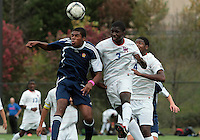 HYATTSVILLE, MD - OCTOBER 26, 2012:  William Kerr (3) of DeMatha Catholic High School  clashes in the air with Azaan Wilbon (15) of St. Albans during a match at Heurich Field in Hyattsville, MD. on October 26. DeMatha won 2-0.