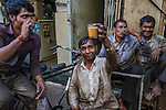 Auto salvagers on a chai break, Mumbai, India