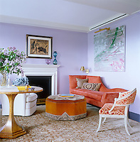 The lilac-painted living room is furnished with a collection of contemporary pieces