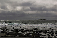 Stormy weather at Bybergsandnen with the lighthouse Feistein in the background. A typical weather for the district Jaeren (Jæren) in Rogaland, Norway.
