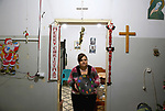 Evet Azzam, a Palestinian Christians woman, 53, makes a handmade clock from recycled newspapers at her house, in Gaza city on Feb. 10, 2017.  Azzam uses an useless home materials to produce clocks, Nylon bags, chairs and tables by air pressure. Photo by Rajab Al- Louh