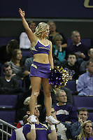 February 12, 2014:   Washington cheer member Sarah Madsen entertained fans during a timeout against Stanford.  Washington defeated Stanford 64-60 at Alaska Airlines Arena in Seattle, Washington.
