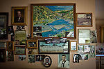 A painting of his mining claim takes center stage among family photos in the home of gold miner James Butler near Smartsville, California, April 19, 2012..CREDIT: Max Whittaker/Prime for The Wall Street Journal.MINER