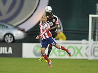 D.C. United defender Brandon McDonald (4)  heads the ball against Chivas USA forward Ryan Smith (22) D.C. United defeated Chivas USA 1-0 at RFK Stadium, Sunday September 23, 2012.