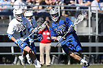 08 February 2015: Air Force's Christopher Allen (26) is chased by Duke's Thomas Zenker (17). The Duke University Blue Devils hosted the United States Air Force Academy Falcons at Koskinen Stadium in Durham, North Carolina in a 2015 NCAA Division I Men's Lacrosse match. Duke won the game 13-7.