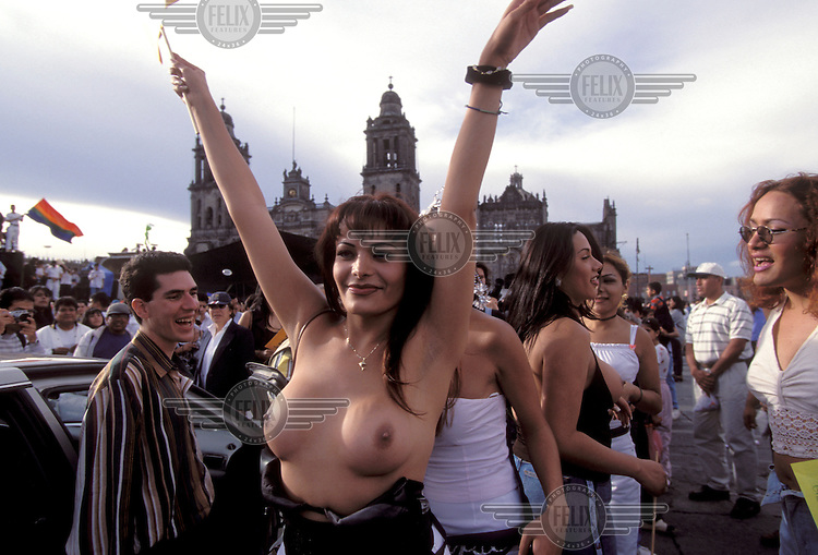 © Mark Henley / Panos Pictures..Mexico City, MEXICO...Transexuals demonstrating for gay rights in the Zocalo, the city's main square, in front of the cathedral.