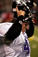 The Dallas Diamonds' Jessica Springer during play against the Houston Energy in the Women's Professional Football League championship. Springer is both a fullback and a linebacker.<br />