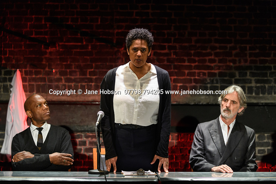 """A brand new adaptation of Albert Camus' """"The Plague"""" opens at the Arcola Theatre. Adapted and directed by Neil Bartlett. Picture shows: Burt Caesar (Grand),  Sara Powell (Dr Rieux), Martin Turner (Mr Tarrou)"""