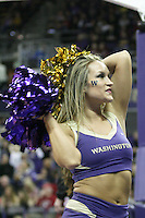February 12, 2014:   UW Cheer member Kayla Woods entertained fans during the game between Washington's against Stanford.  Washington defeated Stanford 64-60 at Alaska Airlines Arena in Seattle, Washington.
