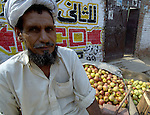 A man sells produce in a market in Lahore, Pakistan....