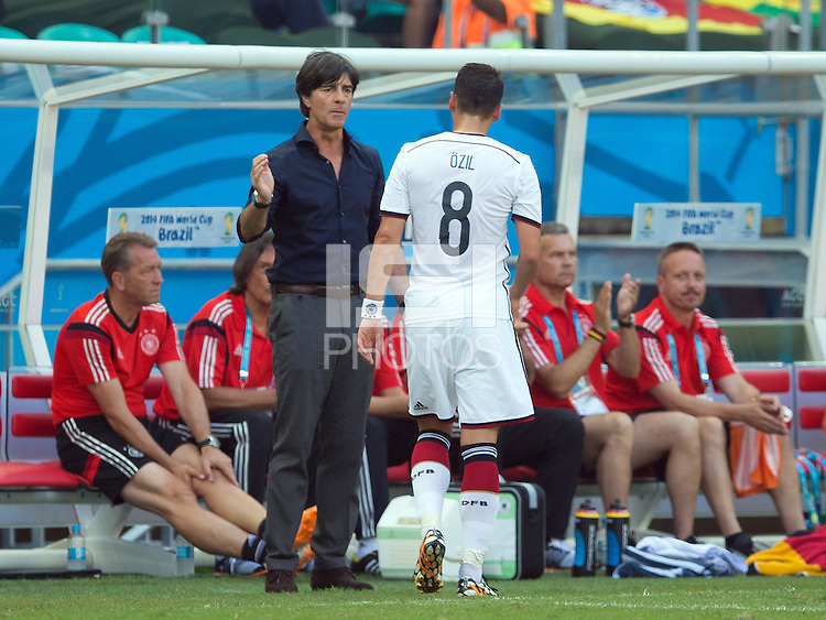 Germany manager Joachim Low shake hands with Mesut Ozil after substituting him off