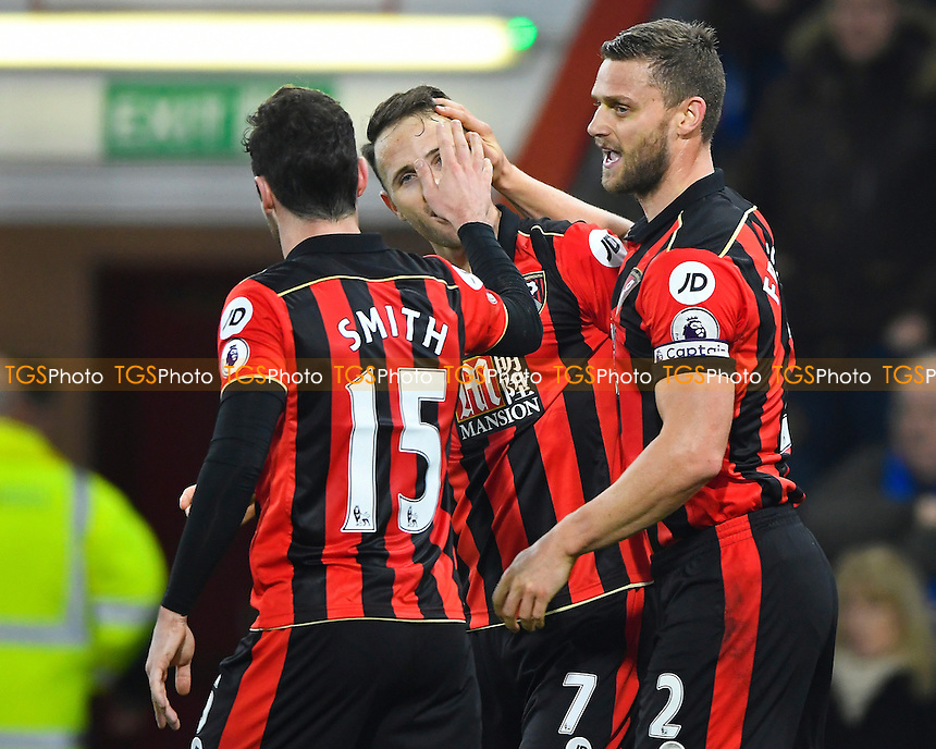 Marc Pugh of AFC Bournemouth (m) is congratulated on scoring the first goal by Simon Francis right and Adam Smith of AFC Bournemouth during AFC Bournemouth vs Leicester City, Premier League Football at the Vitality Stadium on 13th December 2016