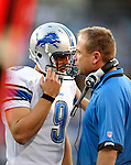 3 September 2009:  Detroit Lions' rookie quarterback Matthew Stafford talks with offensive coordinator Scott Linehan during a pre-season game against the Buffalo Bills at Ralph Wilson Stadium in Orchard Park, New York. The Lions defeated the Bills 17-6...Mandatory Photo Credit: Ed Wolfstein Photo