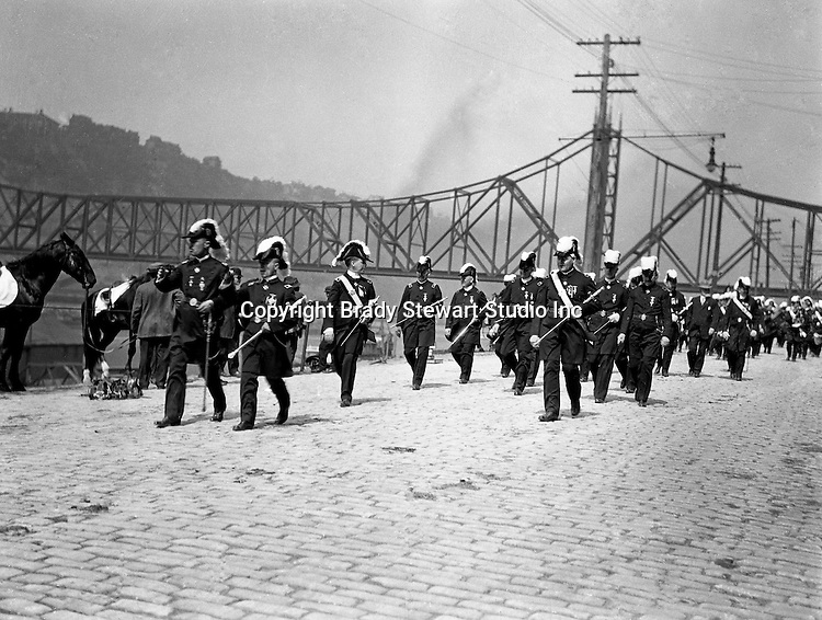 Pittsburgh PA: Homer Stewart marching in the annual Masonic parade on Water Street - 1904. The new Wabash Railroad Bridge is in the background. Homer Stewart, Brady Stewart's father, was prominent in frateral circles. He was a charter member of the Fort Pitt Lodge Free and Accepted Masons; Mount Moriah Council, Royal and Select Masters; 32nd degree member of the Pennsylvania Consistory, Ancient Accepted Scottish Rite, Valley of Pittsburgh; and member of the Syria Temple, Ancient Arabic Order Nobles of the Mystic Shrine.