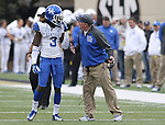 UK head coach Mark Stoops talks to cornerback Fred Tiller during the second half of the University of Kentucky vs. Vanderbilt University football game at Vanderbilt Stadium in Nashville, Tenn., on Saturday, November 16, 2013. Vanderbilt won 22-6. Photo by Tessa Lighty | Staff