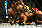 March 1, 2008; Columbus, OH; UFC 82: Pride of a Champion - UFC Middleweight Champion Anderson Silva (yellow/black trunks) defeats Dan Henderson (black/red trunks) via rear naked choke submission in the second round of their bout at the Nationwide Arena in Columbus, OH.