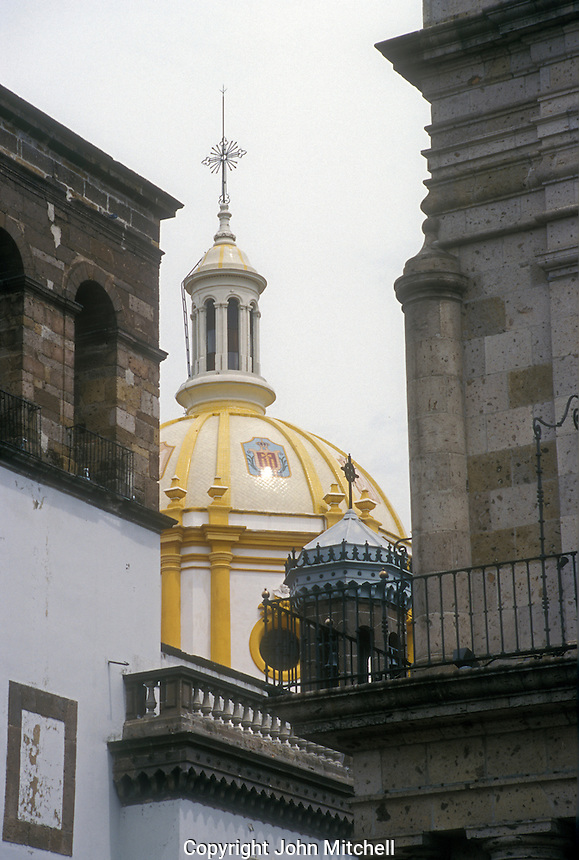 Tiled dome of La Merced church framed by Spanish colonial buildings, Guadalajara, Jalisco, Mexico