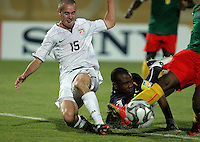 The United States' Brian Ownby (15) makes a drive to goal that is stopped by Cameroon's Francois Beyokol (1) during the FIFA Under 20 World Cup Group C Match between the United States and Cameroon at the Mubarak Stadium on September 29, 2009 in Suez, Egypt.