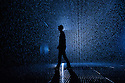 London, UK. 03.10.2012. Random International's experimental, interactive artwork RAIN ROOM opens to the public in The Curve art gallery space at The Barbican Centre. Picture shows: One of the artists, Florian Ortkrass, in the Rain Room. Photo credit: Jane Hobson.