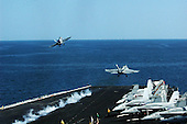 North Arabian Sea - December 7, 2009 -- Two F/A-18 Hornets launch Monday, December 7, 2009 from the aircraft carrier USS Nimitz (CVN 68). The Nimitz Carrier Strike Group is deployed to the U.S. 5th Fleet area of responsibility supporting Operation Enduring Freedom..Mandatory Credit: James Mitchell - U.S. Navy via CNP