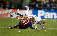 David Beckham is upended by Real Salt Lake's  Chris Wingert (17) in the first half of play. Real Salt Lake defeated the Los Angles Galaxy on penalty kicks to win the 2009 MLS Cup at Qwest Field, Sunday, Nov. 22, 2009.