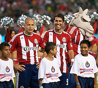 CARSON, CA – August 27, 2011: Chivas USA forwards Alejandro Moreno (15) and Juan Pablo Angel (9) before the match between Chivas USA and Real Salt Lake at the Home Depot Center in Carson, California. Final score Chivas USA 0, Real Salt Lake 1.