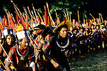Altamira, Brazil. Group of Indian tribesmen with spears and bordunas in a ceremonial dance.
