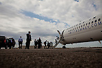Republican vice presidential candidate Rep. Paul Ryan boards his campaign plane at the Cleveland-Hopkins International Airport in Cleveland, Ohio, October 17, 2012.