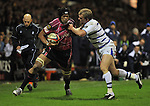 Maama Molitika pushes away Jack Cuthbert. Cardiff Blues V Bath, EDF Energy Cup. &copy; Ian Cook IJC Photography iancook@ijcphotography.co.uk www.ijcphotography.co.uk