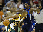SeattleSuperSonics' Ray Allen (L) drives against Dallas Mavericks' Josh Howard in the second period of their game at the Key Arena in Seattle, Washington Wednesday, 13 April  2005.. . Jim Bryant Photo. &copy;2010. All Rights Reserved.