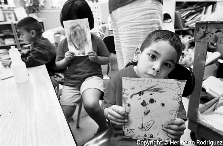 Mexican children attend classes at the Home of the Children kindergarten in the Chicago neigborhood of Pilsen, June 14, 2002. Hundreds of children from Mexico study in different primary schools while their parents work in the city . Photo by Heriberto Rodriguez