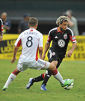 Nick De Leon (18) of D.C. United goes against Chris Tierney (8) of the New England Revolution. The New England Revolution defeated D.C. Untied 2-1, at RFK Stadium, Saturday July 27 , 2013.