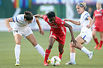 19 June 2015: Portland's Genoveva Ayo Anonma (EQG) (8) is defended by Kansas City's Yael Averbuch (14) and Jen Buczkowski (right). The Portland Thorns FC hosted FC Kansas City at Providence Park in Portland, Oregon in a National Women's Soccer League 2015 regular season match. The game ended in a 1-1 tie.