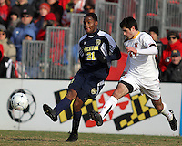 Latif Alashe #21 of the University Michigan during an NCAA quarter-final match against the University of Maryland at Ludwig Field, University of Maryland, College Park, Maryland on December 4 2010.Michigan won 3-2 AET.