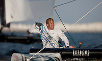 Extreme Sailing Series 2011. Leg 1. Muscat. Oman.Day 5 of racing.   Picture showing David Carr trimmer of Oman Air.