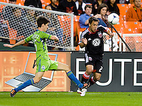 Danny Cruz (2) of D.C. United fights for the ball with Leo Gonzalez (12) of the Seattle Sounders during the game at RFK Stadium in Washington DC.   D.C. United tied  the Seattle Sounders, 0-0.