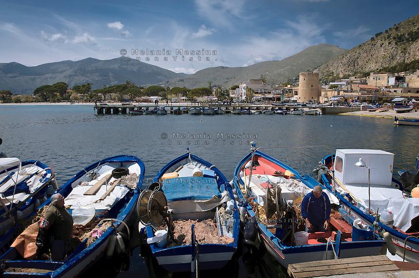 fishermen in the harbor of Mondello.<br /> pescatori nel porticciolo di Mondello