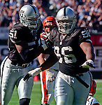 Oakland Raiders vs. Cincinnati Bengals at Oakland Alameda County Coliseum Sunday, October 25, 1998.  Raiders beat Bengals 27-10.  Oakland Raiders defensive end Lance Johnstone (51) and defensive end Darrell Russell (96).