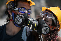 n this Tusday, Jun. 11, 2013 photo, a couple of protesters kiss each other as they wear anti gas masks during clashes between protesters and the anti-riot police at the streets of Taksim Square in Istanbul,Turkey. (Photo/Narciso Contreras).