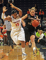Feb. 7, 2011; Charlottesville, VA, USA; Florida State Seminoles guard Alexa Deluzio (3) is fouled by Virginia Cavaliers guard Ariana Moorer (15) during the first half of the game at the John Paul Jones Arena.  Mandatory Credit: Andrew Shurtleff-US PRESSWIRE