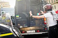 ITA: Manifestatnti davanti al Ministero dell'Economia, Roma 19 Ottobre 2013. Decine di migliaia di persone sono scese in piazza per protestare contro le misure di austerità e tagli di bilancio in Italia. (Foto di Adamo Di Loreto/BuenaVista*photo) ENG: Clashes between police and demonstrators during an anti-austerity protest on October 19, 2013 in Rome. Tens of thousands of people took to the streets to protest against the austerity measures and budget cuts in Italy. (Photo credit Adamo Di Loreto/BuenaVista*photo)
