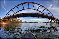 Nothing beats a sunny afternoon in Austin, Texas. I spent this evening kayaking around on the Colorado River underneath Pennybacker Bridge (the 360 Bridge). This image was taking with a 15mm fisheye lens. You can see the end of the kayak poking into the frame.