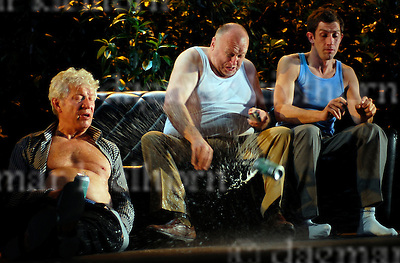 Willy Loman (Thomas Thieme) gets aggresive and throws away his beer can when Charley tries to offer a job to him,Charley (l, Michael Rastl,Happy,r, Andre Szymansky)-Death of a Salesman-Arthur Miller-Conductor Luk Perceval,Schaubuehne am Lehniner Platz,Berlin,Germany