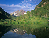 Summer view of Maroon Bells reflected in Maroon Lake, White River National Forest, Colorado, USA.