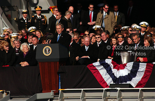 Norfolk, VA - January 10, 2009 -- President of the United States George W. Bush speaks at the commissioning of ceremony for the aircraft carier USS George H.W. Bush (CVN 77). Present at the ceremony are his parents, former first lady Barbara Bush and the ship?s namesake, former President George H.W. Bush. .Credit: Eric S. Garst - U.S. Navy via CNP