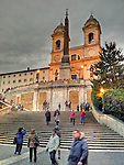 The Church of the Santissima Trinità al Monte Pinco and its obelisk monument at the top of the Spanish Steps seems to glow as the lights come on in the evening.  (Rome, Italy) (HDR image)